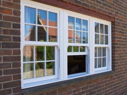 Вертикально сдвижные окна